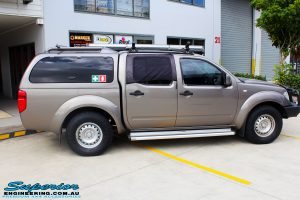 """Right side view of a Nissan D40 Navara Dual Cab before fitment of a Superior Nitro Gas 2"""" Inch Lift Kit with King Springs & a Safari Snorkel"""