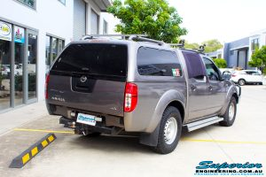 """Rear right view of a Nissan D40 Navara Dual Cab before fitment of a Superior Nitro Gas 2"""" Inch Lift Kit with King Springs & a Safari Snorkel"""