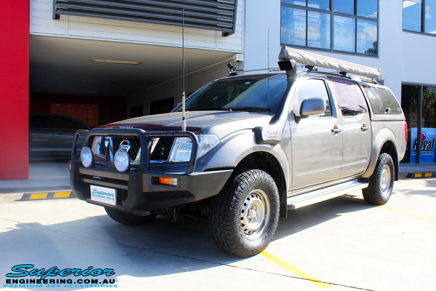 "Left front side view of a Nissan D40 Navara Dual Cab after fitment of a Superior Nitro Gas 2"" Inch Lift Kit with King Springs & a Safari Snorkel"
