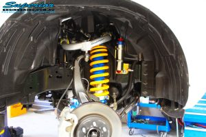 Inner right side guard view of the fitted Superior Adjustable Chromoly Upper Control Arm, Superior Adjustable Monotube Remote Reservoir Strut with Mount & Coil Spring