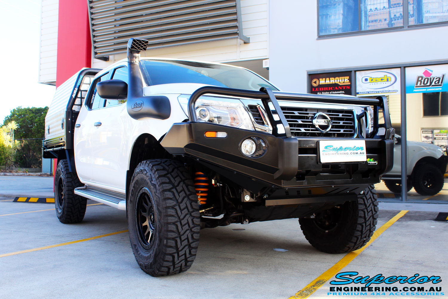 Right front side view of a Nissan NP300 Navara Dual Cab after fitment of a wide range of Superior 4wd Suspension and 4x4 Accessories