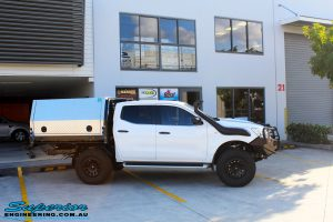 Right side view of a Nissan NP300 Navara Dual Cab after fitment of a wide range of Superior 4wd Suspension and 4x4 Accessories