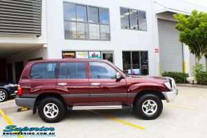 """Left side view of a Maroon Toyota 105 Series Landcruiser Dual Cab before fitment of a Superior Nitro Gas 3"""" Inch Lift Kit with Airbag Man 3"""" Coil Air Kit"""