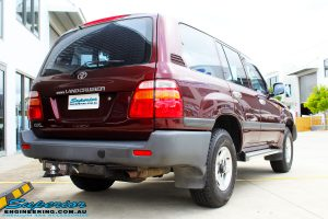 """Rear right view of a Maroon Toyota 105 Series Landcruiser Dual Cab before fitment of a Superior Nitro Gas 3"""" Inch Lift Kit with Airbag Man 3"""" Coil Air Kit"""