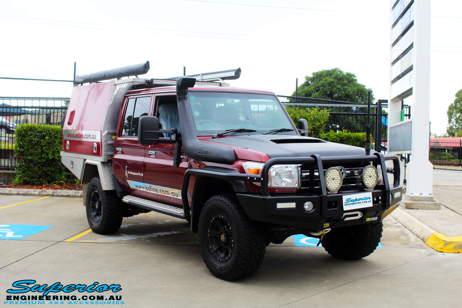Right front side view of a Maroon Toyota 79 Series Landcruiser before fitment of a Superior Upgraded Brake Booster