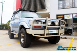 "Right front side view of a Blue Marlin Toyota 80 Series Landcruiser Wagon after fitment of a Superior Nitro Gas 2"" Inch Lift Kit, Superior Radius Arm Rear Bushes & Superior Swaybar Extensions"