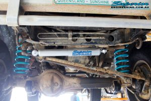 Front underbody looking back on the fitted Superior Steering Damper with Coil Springs & Nitro Gas Shocks