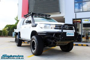 Right front side view of a White Toyota Revo Hilux Dual Cab before fitment of Adjustable Remote Reservoir Front Struts & King Coil Springs
