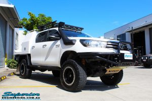 Right front side view of a White Toyota Revo Hilux Dual Cab after fitment of Adjustable Remote Reservoir Front Struts & King Coil Springs