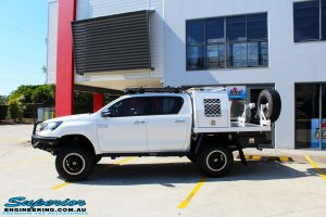 Right side view of a White Toyota Revo Hilux Dual Cab after fitment of Adjustable Remote Reservoir Front Struts & King Coil Springs
