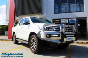 """Right front side view of a Toyota Revo Hilux Dual Cab in White before fitment of a Superior Nitro Gas 2"""" Inch Lift Kit"""