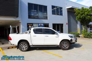 """Right side view of a Toyota Revo Hilux Dual Cab in White before fitment of a Superior Nitro Gas 2"""" Inch Lift Kit"""