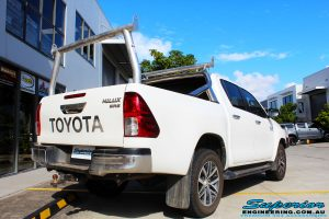 """Rear right view of a Toyota Revo Hilux Dual Cab in White before fitment of a Superior Nitro Gas 2"""" Inch Lift Kit"""
