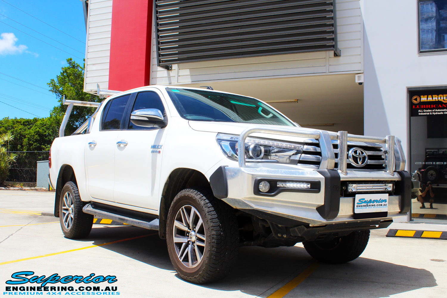 "Right front side view of a Toyota Revo Hilux Dual Cab in White after fitment of a Superior Nitro Gas 2"" Inch Lift Kit"