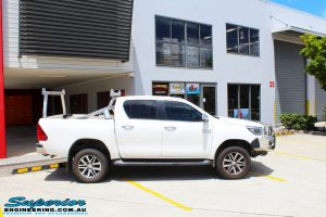 """Right side view of a Toyota Revo Hilux Dual Cab in White after fitment of a Superior Nitro Gas 2"""" Inch Lift Kit"""