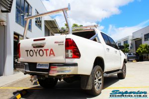 """Rear right view of a Toyota Revo Hilux Dual Cab in White after fitment of a Superior Nitro Gas 2"""" Inch Lift Kit"""