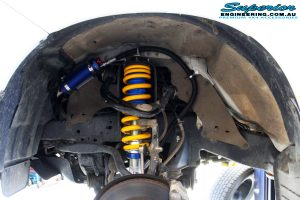 """Front right inside guard view of the fitted front Superior 2"""" Adjustable Monotube Remote Reservoir Strut + Coil Spring"""