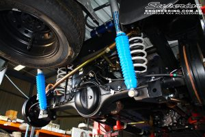 """Rear right side shot of the fitted Superior 2"""" Adjustable Monotube Remote Reservoir Shocks with Coil Springs, Rear Adjustable Panhard Rod and Coil Retainer"""