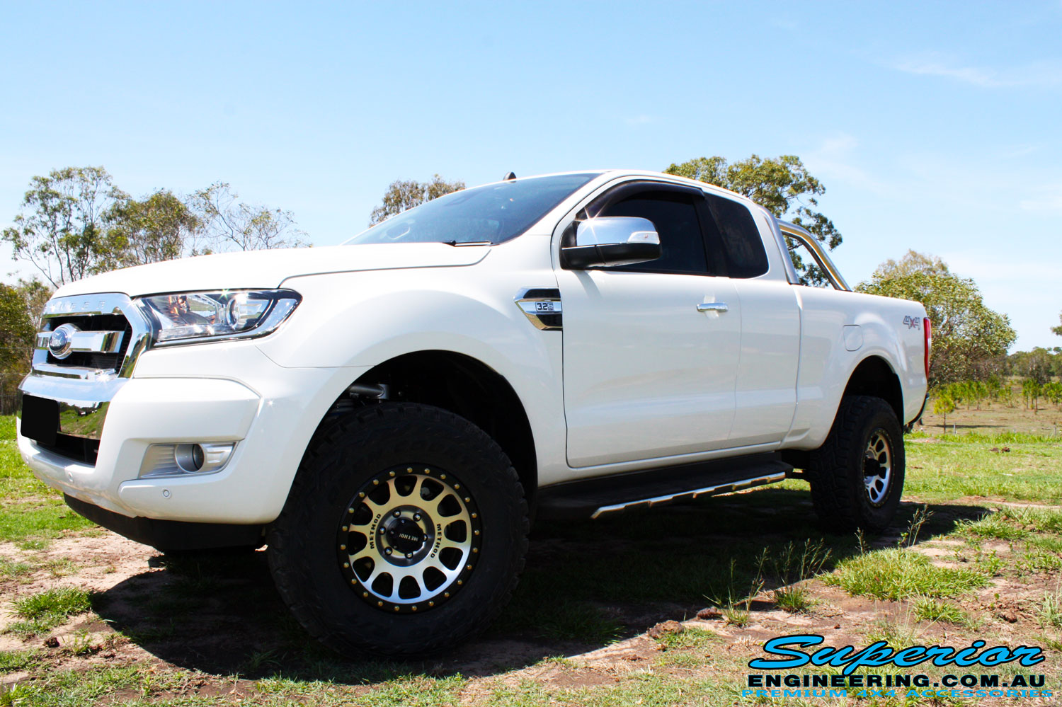 "Front left side view of a White Ford PXII Ranger Dual Cab after fitment of a Superior 2"" Inch Rear PXII Ranger Coil Conversion Kit with Redarc Dual Battery Setup"