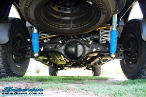 """Rear underbody shot of the fitted Superior 2"""" Adjustable Monotube Remote Reservoir Shocks with Coil Springs and Rear Adjustable Panhard Rod"""