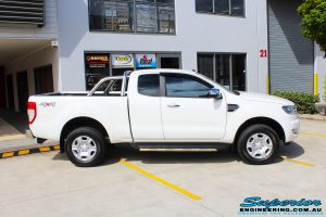 """Right side view of a White Ford PXII Ranger Dual Cab before fitment of a Superior 2"""" Inch Rear PXII Ranger Coil Conversion Kit with Redarc Dual Battery Setup"""