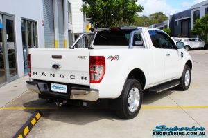 """Rear right side view of a White Ford PXII Ranger Dual Cab before fitment of a Superior 2"""" Inch Rear PXII Ranger Coil Conversion Kit with Redarc Dual Battery Setup"""