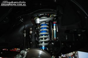 """Front right inside shot of the fitted 2"""" Inch Superior Adjustable Monotube Remote Reservoir 2"""" Front Strut with Coil Spring"""