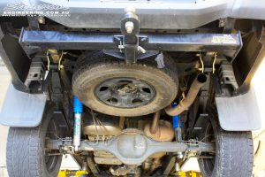 """Rear left underbody shot of the fitted Superior Nitro Gas 2"""" Shock + EFS Leaf Spring with U-Bolt Kit"""
