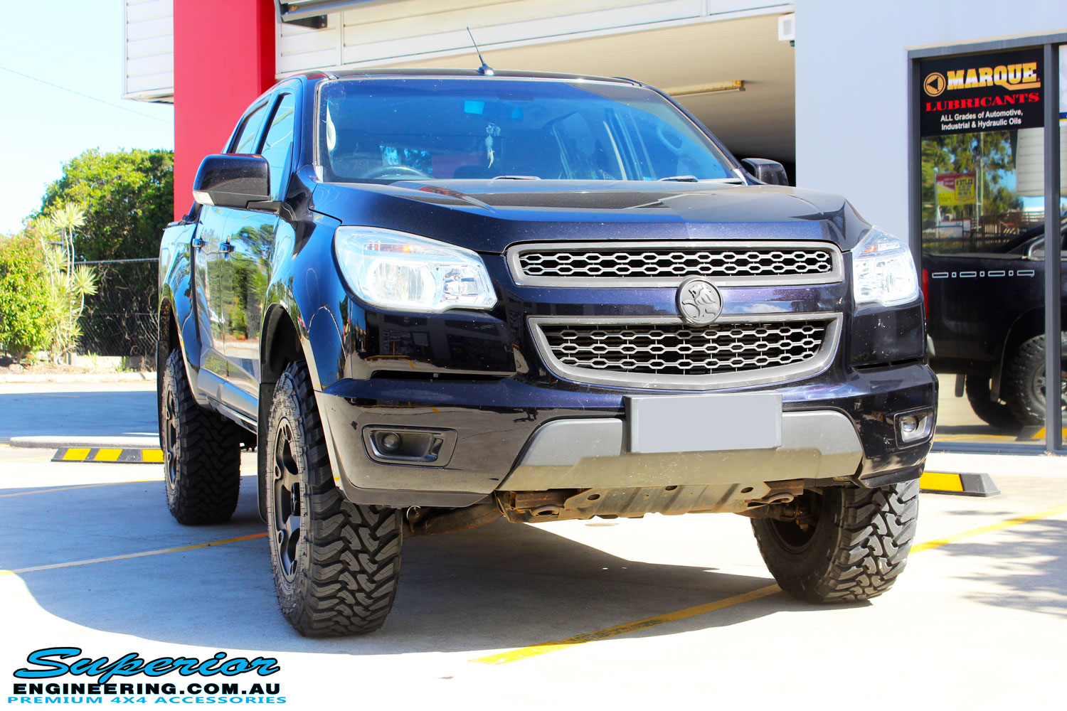 "Front on shot of a Black Holden RG Colorado Dual Cab after fitment of a Superior Nitro Gas 2"" Inch Lift Kit with King Coil Springs, Fuel Beast Wheels & Toyo Open Country Tyres"