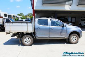 Right side view of a Holden RG Colorado Dual Cab in Grey ready to be On The Hoist @ Superior being fitted with a Chassis Brace/Repair Plate