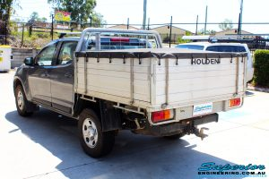 Rear left view of a Holden RG Colorado Dual Cab in Grey ready to be On The Hoist @ Superior being fitted with a Chassis Brace/Repair Plate