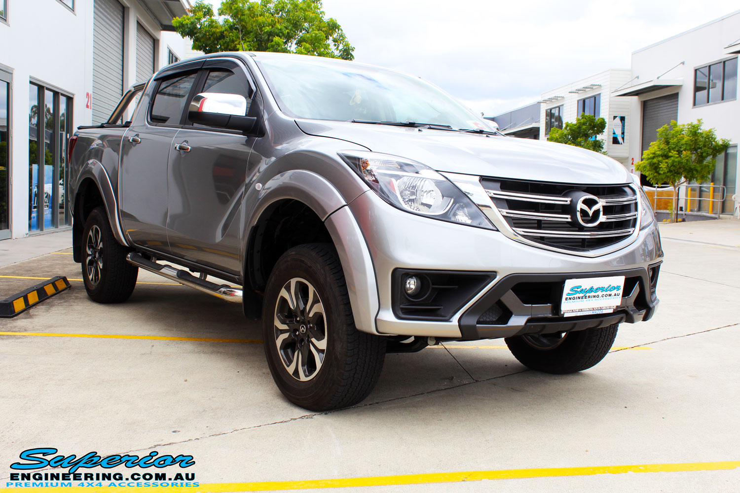 "Left front side view of a Mazda BT50 Dual Cab in Silver after fitment of a Superior Nitro Gas 2"" Inch Lift Kit with King Coil Springs"