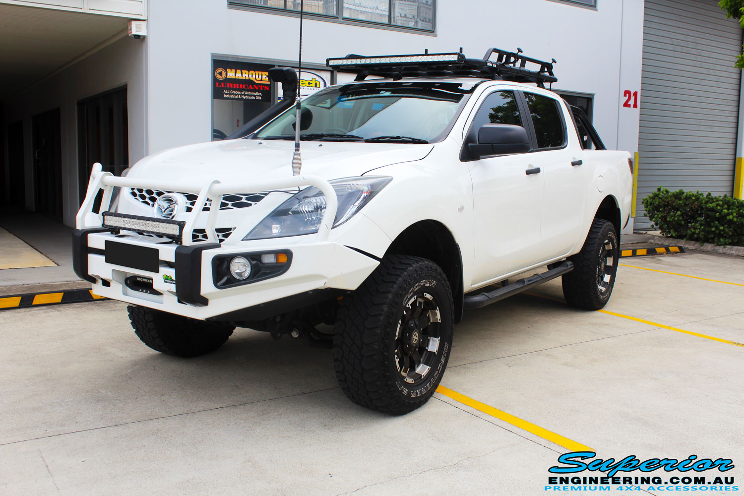 Left front side view of a Mazda BT50 Dual Cab after fitment of a wide range of Superior 4wd Suspension