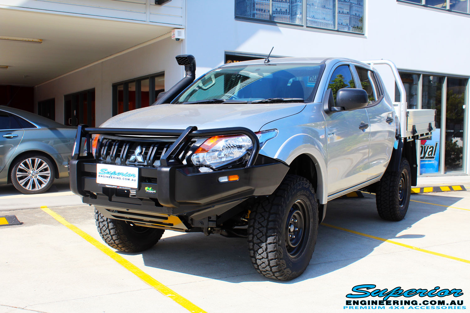 Left front side view of a Mitsubishi MQ Triton Dual Cab after fitment of a Ironman 4x4 Bullbar