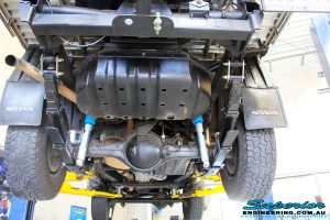 """Rear mid underbody shot of the fitted Superior 2"""" Nitro Gas Shocks & Dobinson Leaf Springs and Superior U-Bolt Plate Kit"""