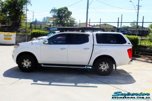 """Left side view of a Nissan NP300 Navara Dual Cab before fitment of a Bilstein 2"""" Inch Lift Kit with King Coil Springs"""