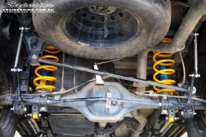 """Rear mid underbody view of the fitted Bilstein 2"""" Shocks with King Coil Springs and Superior Sway Bar Extensions"""