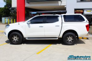 """Left side view of a Nissan NP300 Navara Dual Cab after fitment of a Bilstein 2"""" Inch Lift Kit with King Coil Springs"""