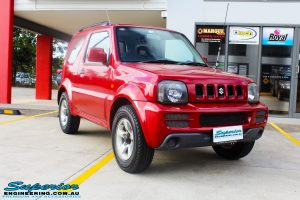 """Right front side view of a Suzuki Jimny in Red before fitment of a EFS 2"""" Lift Kit"""