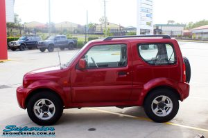 """Left side view of a Suzuki Jimny in Red before fitment of a EFS 2"""" Lift Kit"""