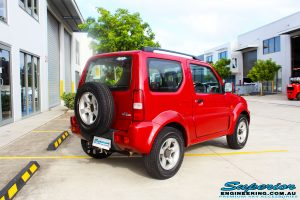 """Rear right side view of a Suzuki Jimny in Red before fitment of a EFS 2"""" Lift Kit"""