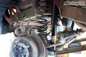 """Front left close up guard view of the fitted EFS 2"""" Elite Front Shock with EFS Coil Spring"""