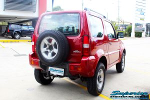 "Rear right side view of a Suzuki Jimny in Red after fitment of a EFS 2"" Lift Kit"
