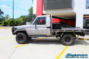 """Left side view of a Silver Toyota 79 Series Landcruiser after fitment of a Superior Nitro Gas 2"""" Inch Lift Kit"""