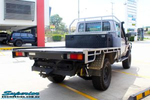 """Rear left view of a Silver Toyota 79 Series Landcruiser after fitment of a Superior Nitro Gas 2"""" Inch Lift Kit"""