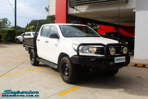 """Right front side view of a White Toyota Revo Hilux Dual Cab before fitment of a Superior 4"""" Inch Lift Kit"""