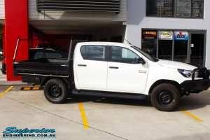 """Right side view of a White Toyota Revo Hilux Dual Cab before fitment of a Superior 4"""" Inch Lift Kit"""