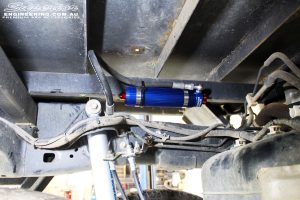 Right rear underbody chassis close up shot of the fitted Remote Reservoir with mount