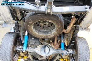 Mid underbody view of the fitted Superior Remote Reservoir Shocks with Leaf Springs