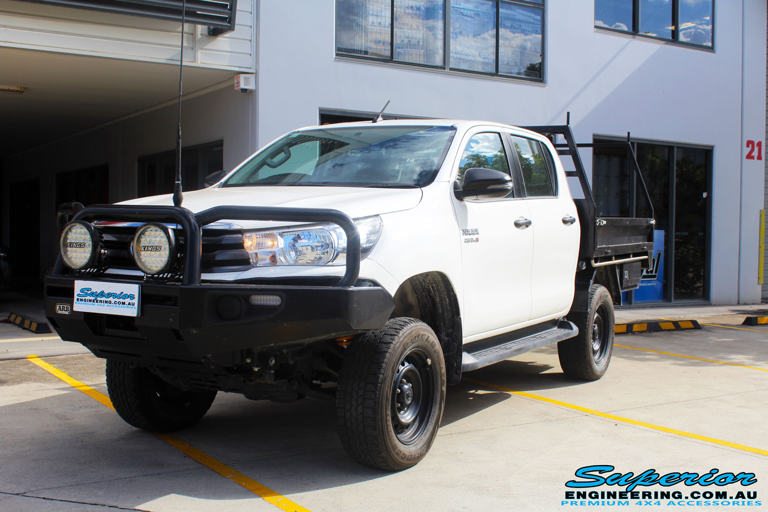 "Left front side view of a White Toyota Revo Hilux Dual Cab after fitment of a Superior 4"" Inch Lift Kit"